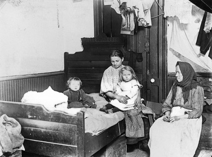 Immigrant women and children at home, New York, c 1908-1918.
