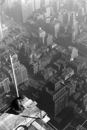 Construction worker high above the street, New York, c 1933.
