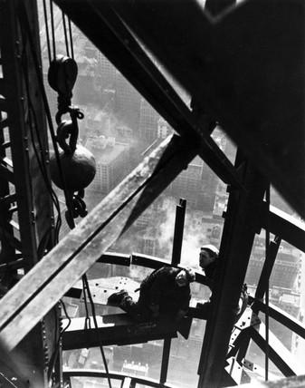 Construction men working on a mooring mast, USA, c 1930s.