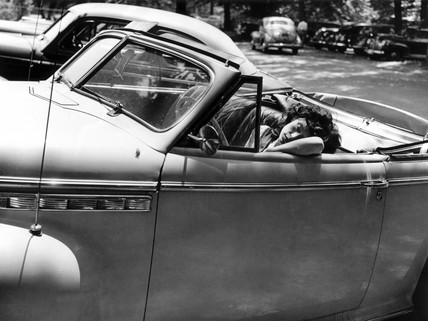 Woman sleeping in a car, Rock Creek park, Washington DC, USA, 1942.