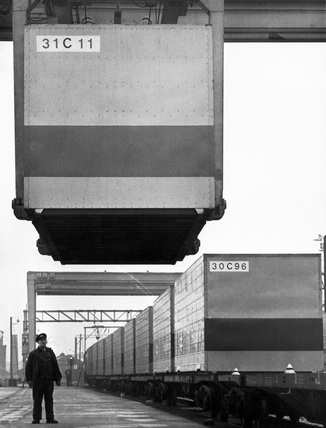 Container being lowered onto a freight train, March 1966.