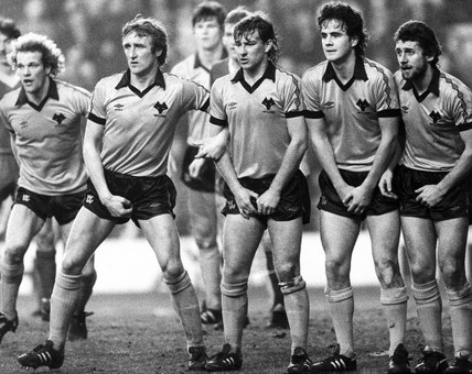 Wolverhampton Wanderers guard against a Liverpool free kick, 1980s.
