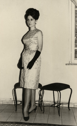Woman in evening dress, 1950-1960s.