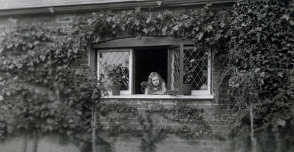 Girl at a garden window, mid-late 19th century.