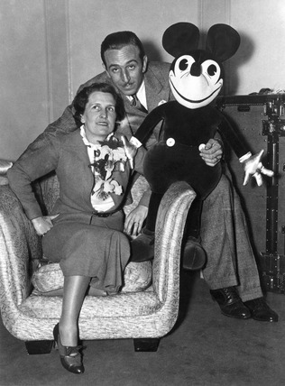Mr and Mrs Walt Disney with Mickey Mouse, London, 21 June 1935.