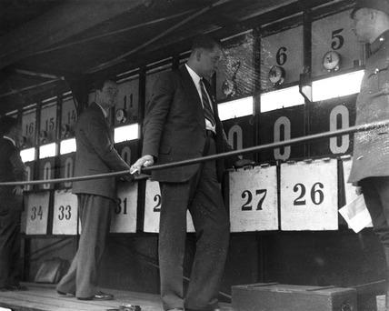 Lap scorers at a motor racing track, Berlin, 1932.
