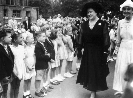 The Queen Mother visiting Peterborough School, Fulham, London, 17 July 1952.