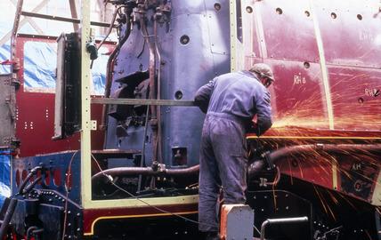Working on the 'Duchess of Hamilton' steam locomotive, c 1980s.