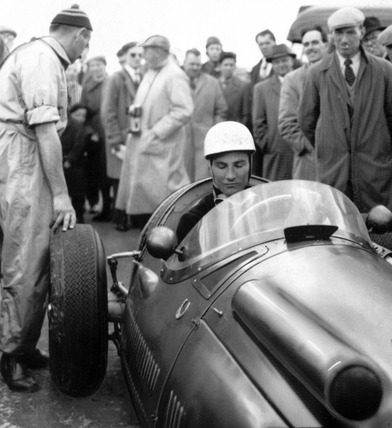 Stirling Moss in a Maserati, Italy, May 1955.