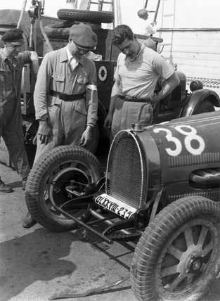 Prince Lobkowicz examining his Bugatti Type 54 racing car, Berlin, 1932.