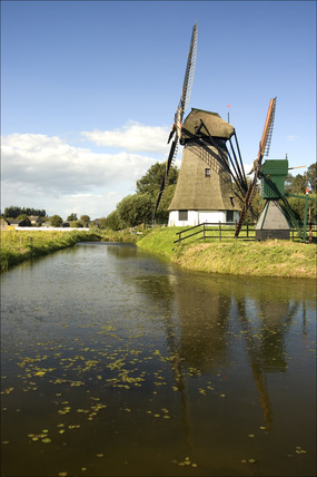 Windmills by a canal, Netherlands, 2007.