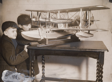 Schoolboys with a model of a seaplane, Schoolboys' Exhibition, December 1933.