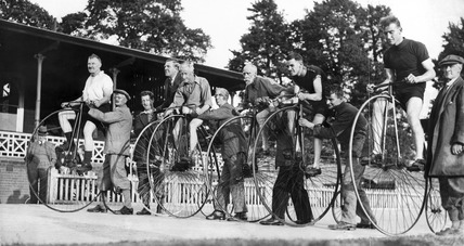 Penny farthing race, Herne Hill velodrome, London, c 1930s.