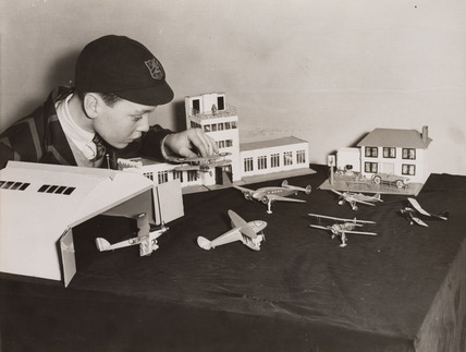 Boy with model airport, Selfridges, London, December 1936.