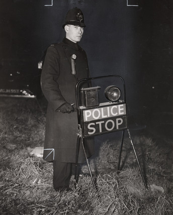A police patrol looking for black marketeers, Britain, 1948.