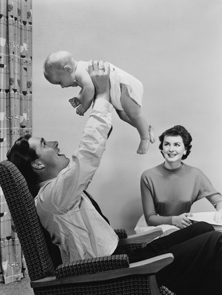 Young couple and baby, 1956.