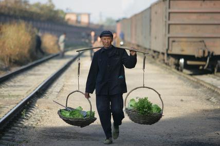 Returning from the allotment, Meiheikou, Jilin province, China, 2005