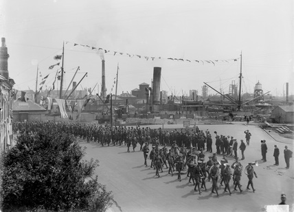 General View of American Troops Marching Past Docks Offices. Newport Docks, South Wales, 1924.