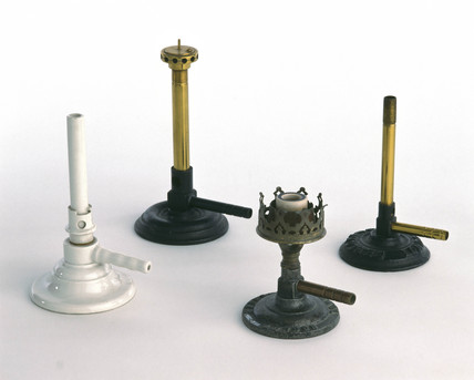 Three Bunsen burners and an Argand gas burner, late 19th-early 20th century.