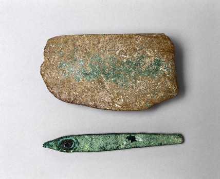Bronze chisel and sharpening stone, Egypt, c 3000 BC.