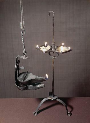 Simple iron oil lamps, c 1770-1830.