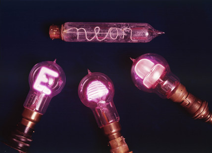 Four neon lights, c 1920.