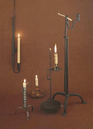 Five candlesticks with candles, 19th century.