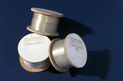 Three spools of polyethylene terephthalate filaments, 1943-1944.
