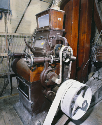 Grinding machinery used to produce casein plastic, 1900.