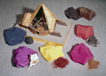 Natural dyes shown with dyed fabrics and a model of a woad mill.