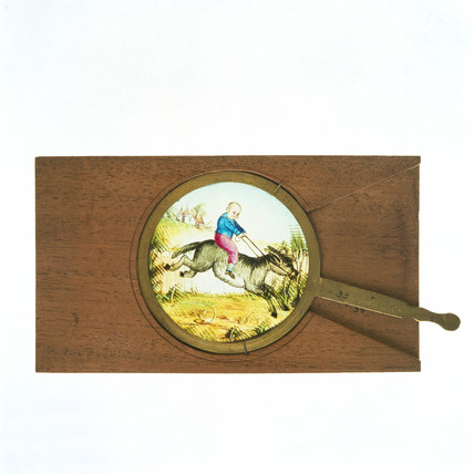 Magic lantern slide with turning handle.