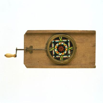 Magic lantern slide with winding handle.