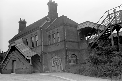 Exterior view of Earls Colne railway station. Essex, England, 1953.