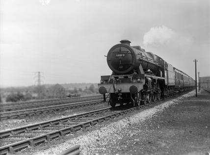 London Midland Scotland (LMS) rebuilt Royal Scot 4-6-0 locomotive 46162 'The Queen's Westminster Rifelman' leaving Reading, 17th May 1948.