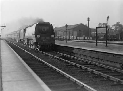 British Railways (B.R.) locomotive 35017 'Belgian Marine' on up Perth express passing Harrow 1948.