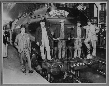 Sir Nigel Gresley and crew stood on buffer beam of London North Eastern Railway (LNER). Locomotive no. 10000 class W1 as Flying Scotsman. (NRM_PHA_106)