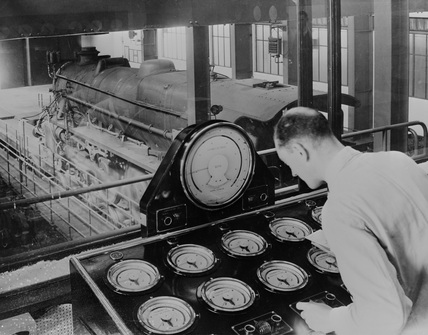 Operator at control desk, Rugby Test Plant.