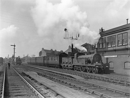 Southern Railway (S.R.) Stirling F class locomotive no. 194. On a local train at Folkestone.