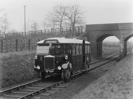 London Midland and Scotland (LMS) Road rail coach on rail. (LMS, LMS_5800)