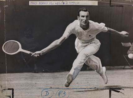 Fred Perry during tennis match at Wimbledon vs. Jack Crawford.