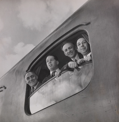 Illustrated' reporters & cameraman in plane at Peace conference.