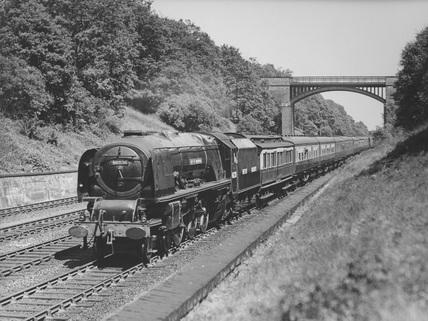 London Midland & Scotland (LMS) 4-6-2 locomotive no. 46236 'City of Bradford' with dynamometer car.