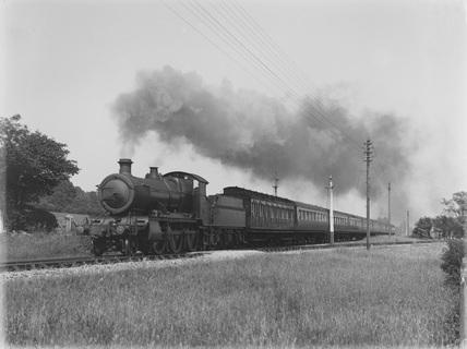 43xx on up express leaving Barnstaple, 9 coaches - 1 clerestory and 8 Collett stock c.1932