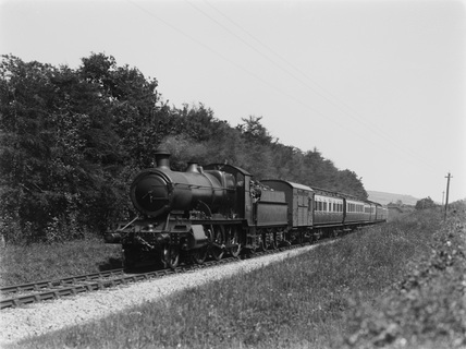 43xx locomotive down local at Ackland Cross c.1930. Horsebox and 7 coaches.