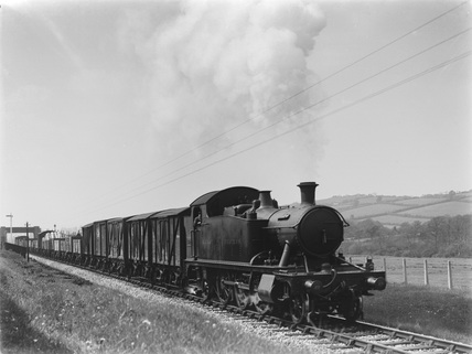 Locomotive no. 5502 up goods at Westcott Lane Bridge, Landkey c.1930