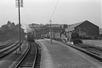 Locomotive no. 5503, Dulverton. Barum train taking water, 28 July 1951.
