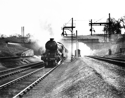 The pioneer G.N.R.'Great Northern' steam locomotive, Class A1, 4-6-2 engine No. 4470, emerging from Wood Green tunnel on a down express, c.1930.
