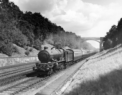 Torbay Express, 13 or 14 coaches behind 'King' Class 4-6-0 steam locomotive, No.6020 'King Henry IV'.