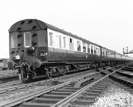 A slip coach is about to be detached from an up train at Reading, 1958
