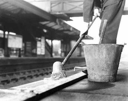 Whitewashing the platform edges at the London, Midland & Scottish Railway's Hatch End station, 1937.